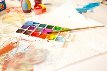 Closeup shot of watercolors with brush