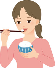 白米を食べる若い女性