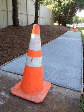 Sidewalk repair with cones at each end