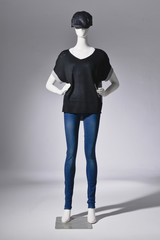 Full female clothing in jeans with hat on two mannequin