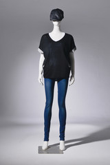 Full length Fashion female clothing in hat on mannequin