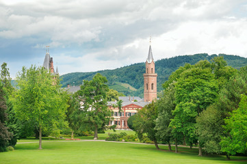 city park with lawns and castle