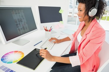 Casual female photo editor using computer