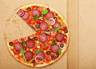 Wall Mural - Salami pizza over box.