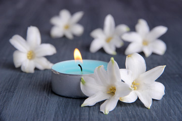 White hyacinth with candle on wooden background