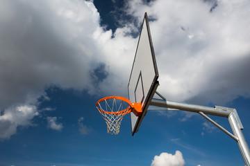 Basketball hoop against  lovely blue summer sky