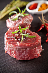 Fresh raw beef steak on black stone