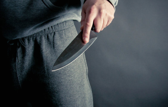 Robber thrusting a knife