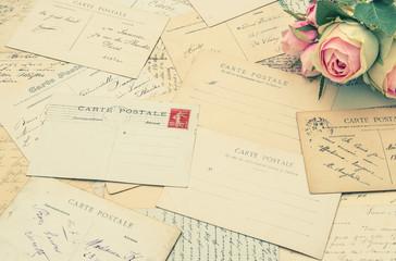 vintage postcards and soft rose flowers. nostalgia