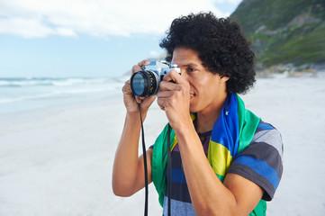 Brazil flag man beach