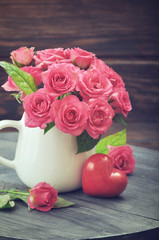 Pink roses with stone heart