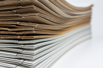 Stack of brown and white paper