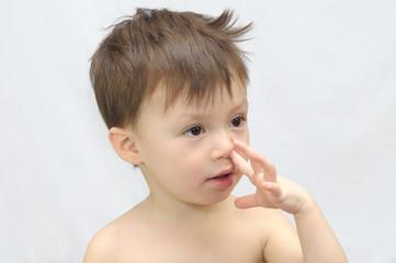 Boy picks his nose