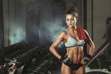 Wall Mural - Woman resting during exercise in the gym