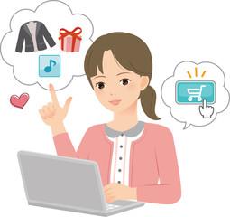 パソコンでオンラインショッピングを楽しむ女性