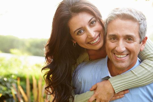 Portrait Of Loving Hispanic Couple In Countryside