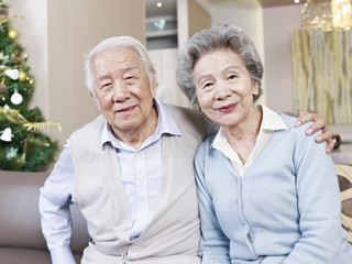home portrait of senior asian couple