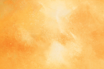 Abstract yellow/orange watercolor background.