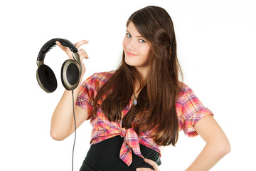a smiling happy girl holds headsets in a hand