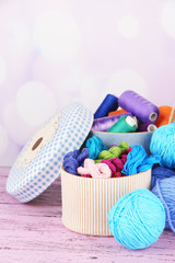 Decorative boxes with colorful skeins of thread