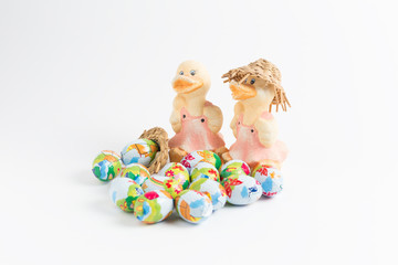 Group of colorful candy Easter eggs with duck