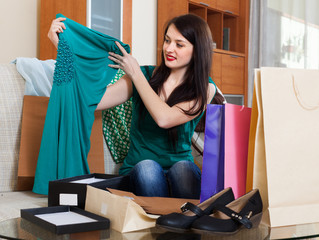 Happy brunette woman looking purchases