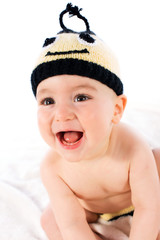 Adorable baby dressed in a bee costume on white