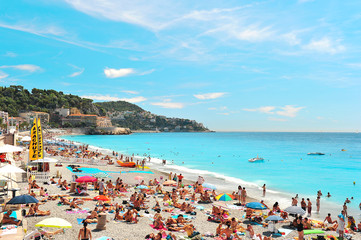 People relaxing on the public beach in Nice