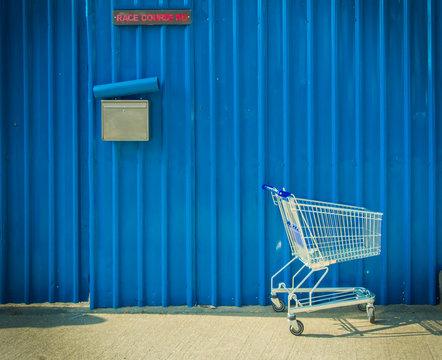 Shopping cart leave beside the street