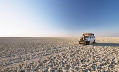 Car in the middle of salt lake near Kubu island