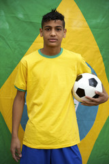 Proud Patriotic Young Brazilian Football Fan Posing with Flag