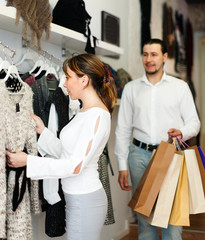 couple  choosing gown at boutique