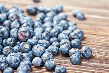 blueberries on old wooden table background