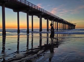 Evening Jogger at Scripps Pier in La Jolla, San Diego, CA, USA