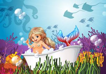 A bathtub under the sea with a mermaid