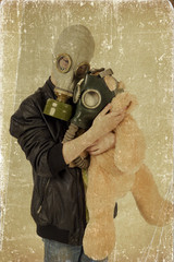 Child with a toy in a gas mask. Grunge effect.