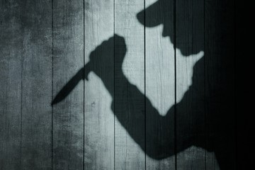Human Silhouette with Knife in shadow on wooden background, XXXL Wall mural
