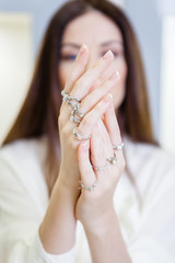 Close up view of female hands with rings