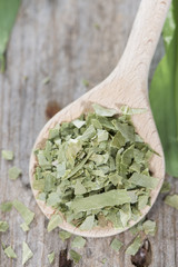 Portion of dried Ramson on a wooden spoon