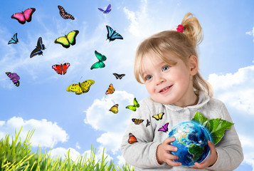 Wall Mural - environment concept, child holding world with flying butterflies