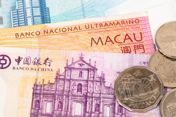 Macau pataca money banknote close-up with coins