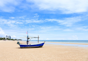 Hua Hin beach with traditional fishing boat
