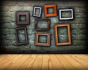 scratched wall full of wood frames