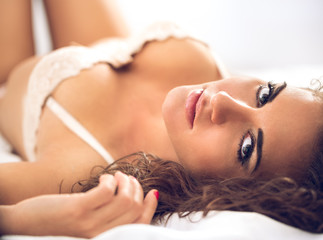 sexual woman relaxing and lying in bed