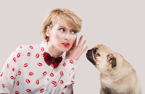 Vintage style woman listening to her dog