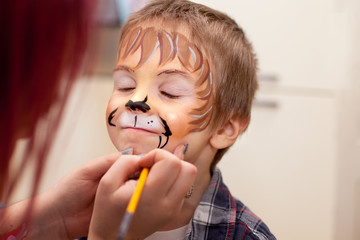 Portrait of a boy with painted face