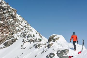 Person ascendind a mountain