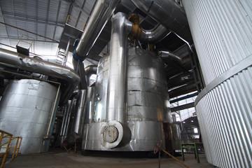 vacuum pans evaporator tanks in a sugar plant