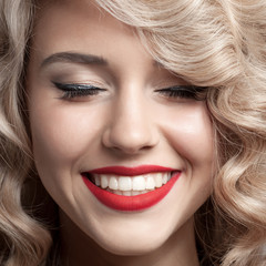 Wall Mural - Close up face of beautiful Woman. Healthy Curly Hair. Gorgeous s