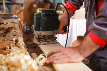 Hands carpenter working with a circular saw